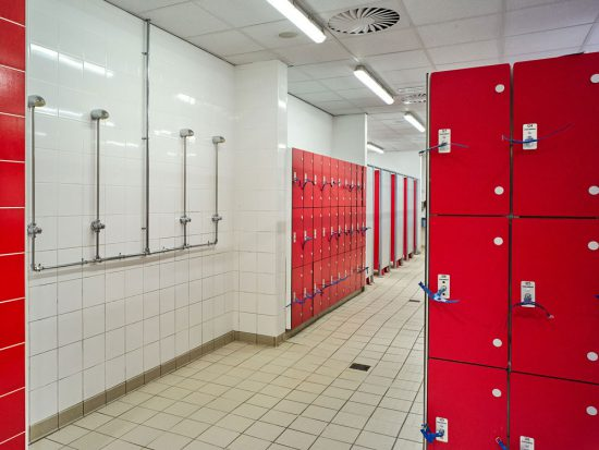 view of the showers and red lockers in the changing rooms at Peel