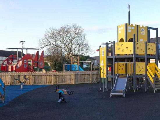 peel pool playground with a red helicopter climbing frame and the yellow castle climbing frame